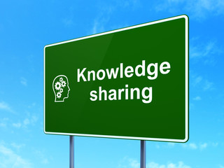 Education concept: Knowledge Sharing and Head With Gears on road