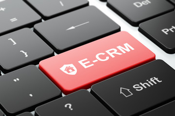 Business concept: Shield and E-CRM on computer keyboard