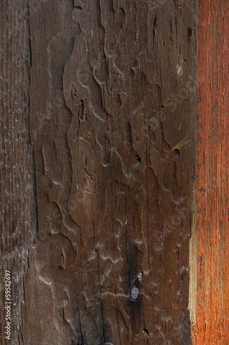 Wooden wall background with rusty chain