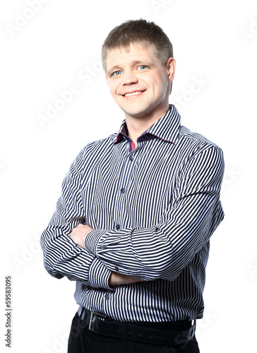Portrait of handsome confident young businessman standing