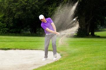 Pro golfer bunker shot