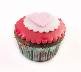 The red cupcake isolated on white background