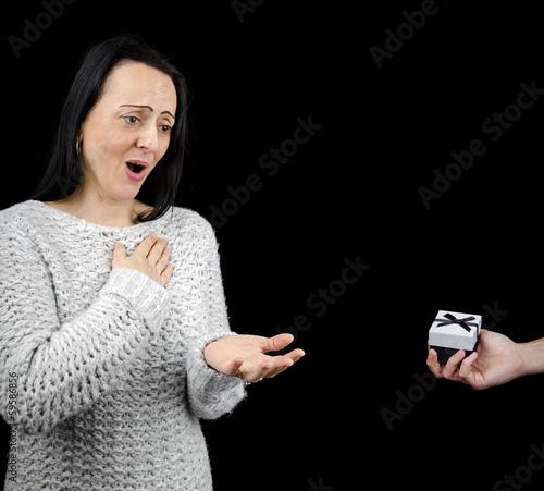 Appreciative woman receiving gift, black background