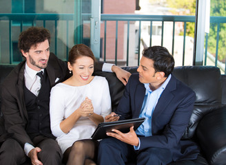 Happy couple in office of finical adviser ready to sign contract
