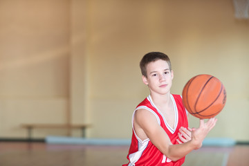 Basketball player with a ball in his hands and a red uniform.  B