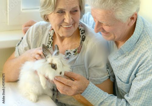 Senior couple with a rabbit