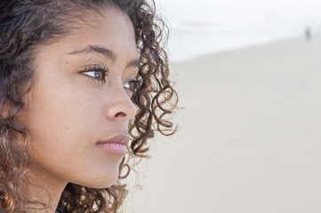 Closeup of young woman at beach