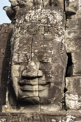 Stone face of Buddha on towers of Bayon temple in Angkor Thom