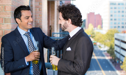 Businessmen, company partners having beer on a balcony