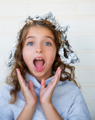 Funny kid girl surprised with his dye hair with foil