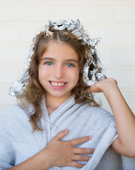 Funny kid girl smiling with his dye hair with foil