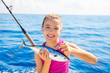 Kid girl fishing tuna little tunny happy with fish catch