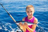 kid girl fishing tuna bonito sarda fish happy with catch poster
