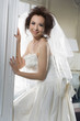 Sexy young beauty woman in bride white dress posing