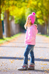 autumn winter kid girl blond with jeans and pink snow cap