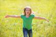 kid girl happy running open hands in green outdoor