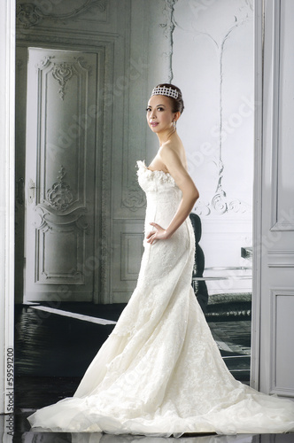 Slim and beautiful woman, wearing luxurious wedding