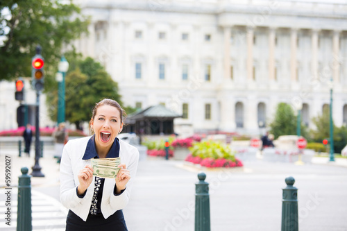 Corrupt politician in Washington DC, holding dollar bills
