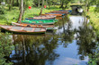 Leinwandbild Motiv Ruderboote an stillem Fluss
