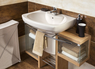 detail of a modern bathroom with sink and accessories