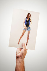 Man holding picture of sexy woman