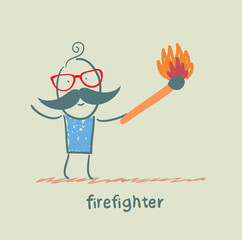 firefighter holding a burning stick