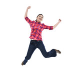 happy young woman jumping with arms extended