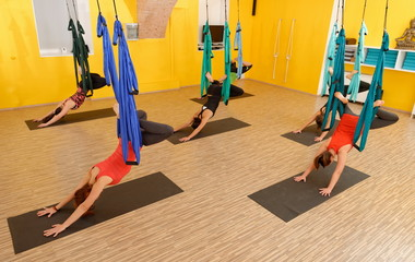 Women doing anti gravity Aerial yoga exercise