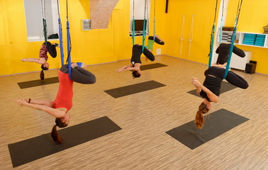 Women doing anti gravity Aerial yoga exercise