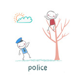 Police near the tree on which sits a criminal