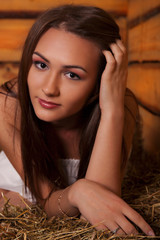 young woman in a hayloft