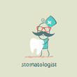 stomatologist holding a tooth