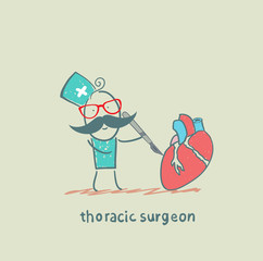 thoracic surgeon operates on the heart with a scalpel