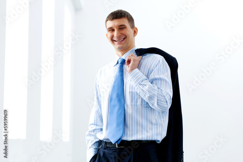 Business man in suit smiling