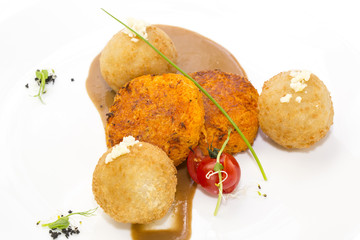 carrot vegetarian meatballs on a white plate in a restaurant