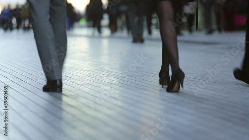 Low angle of busy commuters walking in a business district