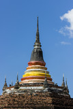 Top of the stupa in Thailand and blue sky.