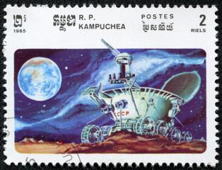 stamp shows moonwalker explores the lunar craters