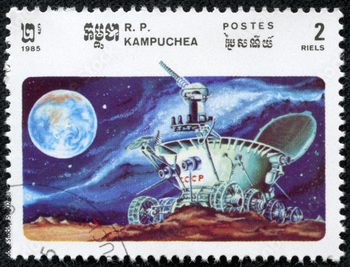 stamp shows moonwalker explores the lunar craters