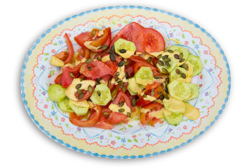 Mediterranean salad with tomato cucumber pumpkin seeds