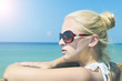 Beautiful young woman in sunglasses on beach.summer sunlight
