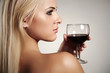 Beautiful Blond woman drinking red wine.naked beauty