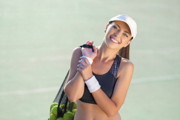 Portrait of a Professional Female Tennis Athlete with Tennis Bal