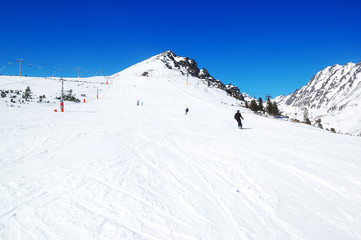 Skiers riding on a slope in Strbske Pleso ski resort, High Tatra