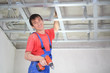 worker is installing ceiling profile for false ceiling