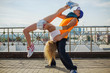 couple doing acrobatic stunts in the street dance