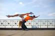 couple dancing modern dance in the street