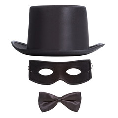 Black top hat, masquerade mask and bow tie isolated on white