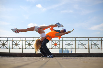 couple dancing modern dance in the street