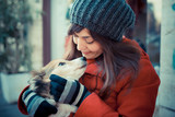 beautiful woman red coat hugging the dog